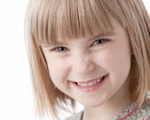 A closeup headshot of a caucasian smiling little real girl — Stock Photo