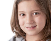 A closeup headshot of an 8 year old caucasian smiling little real girl — Stock Photo