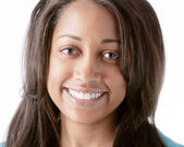 A closeup headshot of a 16 year old black smiling teenage real girl — Stock Photo