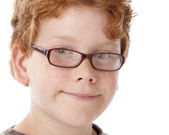 A closeup headshot of a 9 year old caucasian smiling little real boy — Stock Photo