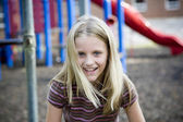 Young girl at recess plays on the playground at school — Stock Photo