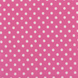 A high resolution pink fabric with white polka dots — ストック写真