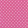 Stock Photo: High resolution pink fabric with white polkdots