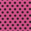 A high resolution pink fabric with black polka dots — Stock Photo