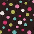 A high resolution brown fabric with multi-colored polka dots — 图库照片