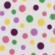 A high resolution white fabric with bright multi-colored polka dots — Stock Photo