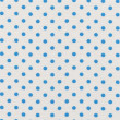 A high resolution white fabric with bright blue polka dots — Lizenzfreies Foto