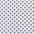 A high resolution white fabric with dark blue polka dots — Foto de Stock