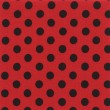 Royalty-Free Stock Photo: A high resolution bright red  fabric with black polka dots