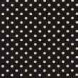A high resolution black fabric with white polka dots — Stock Photo