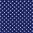A high resolution blue  fabric with white polka dots — 图库照片