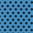 A high resolution blue fabric with black polka dots — Stockfoto