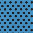 A high resolution blue fabric with black polka dots — Stock Photo
