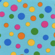 A high resolution blue fabric with multi-colored polka dots — Стоковая фотография