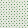 A high resolution white fabric with green polka dots — Stock fotografie