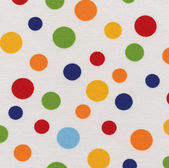 A high resolution white fabric with colorful polka dots — Stock Photo