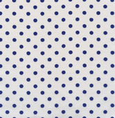A high resolution white fabric with dark blue polka dots — Stock Photo