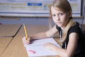 Caucasian little girl in the school classroom — Stock Photo