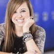 Smiling teenage girl in high school — Stock Photo