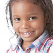 A closeup headshot of a 5 year old mixed race boy - Stock Photo