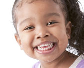A closeup headshot of a 6 year old mixed race girl — Stock Photo