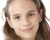 A closeup headshot of a 10 year old mixed race girl — Stock Photo