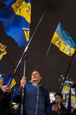 Maidan - young activist with flag of nationalistic party svoboda — Stock Photo