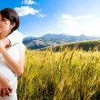 Happy pregnant couple at beautiful sunny day - Stock Photo
