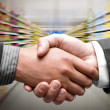 Handshake at supermarket — Stock Photo
