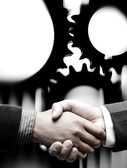 Handshake with gears background — Stock Photo