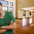 Young successful man at his brand new big house - Stock Photo