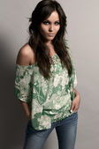 Fashion studio shot of beautiful woman with jeans and green blou — Stock Photo