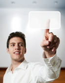 Young successful business man touching digital screen display at office — Stock Photo