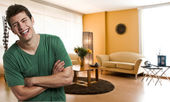 Happy young man at his apartment — Stock Photo