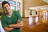 Young successful man at his brand new big house — Stock Photo
