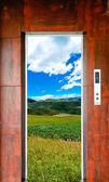 Elevator door and landscape — Stock Photo