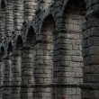 Famous Aqueduct from ancient Segovia, Spain - Stock Photo