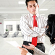 Business woman talking to business man at the office - Stock Photo