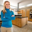 Young happy woman at her big new kitchen — Stock Photo