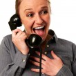 Business woman hearing good news at the phone — Stock Photo