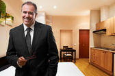 Successful businessman at hotel room — Stock Photo