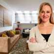Young relaxed woman at her apartment — Stock Photo #19406021