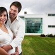 Royalty-Free Stock Photo: Young happy couple at their new big house