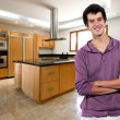 Young man smiling at the kitchen — Stock Photo