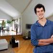 Young msmiling relaxed at his big house — Stock Photo #19407147