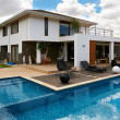 Modern big house with pool - Stock Photo