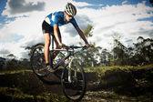 Young man riding a bike — Stock Photo