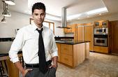 Successful man at his new modern big kitchen — Stock Photo