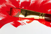 Professional brush with red paint on a white background — Stock Photo