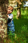 Little beautiful boy playing in the park — Stock Photo